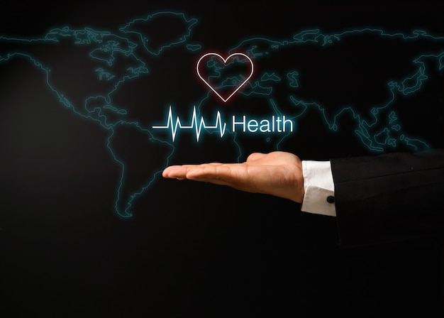 Die hand des mannes mit gesundheitskonzeptdesign Premium Fotos