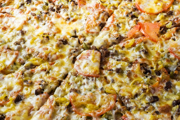 Die oberflächenbeschaffenheit der pizza. nahansicht. Premium Fotos