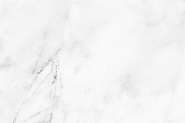 Die weiße schmutzige marmorbeschaffenheit haben staub von und steinmuster. Premium Fotos