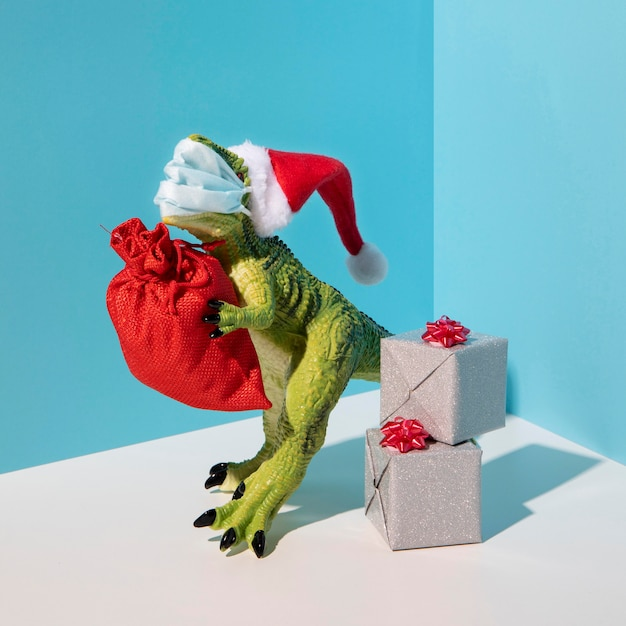 Dinosaurierspielzeug, das medizinische maske trägt Kostenlose Fotos
