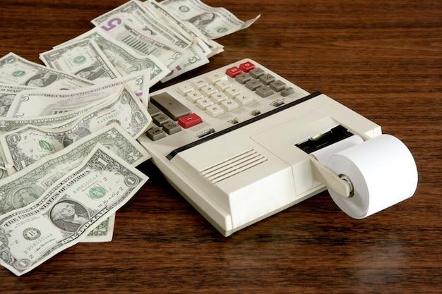 Dollar merkt taschenrechnerbuchhalter-büroweinlese Premium Fotos