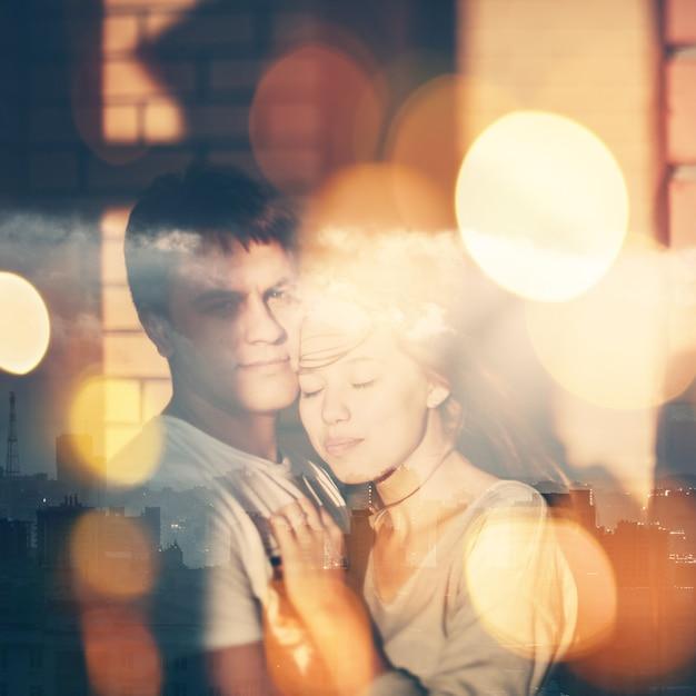 Doppelbelichtungs-porträt von liebevollen paaren Premium Fotos