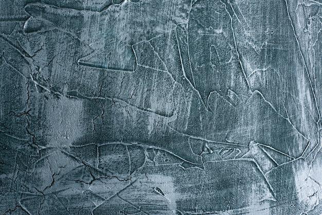 Dramatischer blauer schmutz nahtlose steinbeschaffenheit venezianischen gipshintergrunddekor. gebrochene schmuddelige betonzementdekoration. Premium Fotos