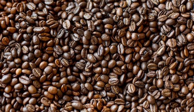 Draufsicht auf geröstete kaffeebohnen Kostenlose Fotos
