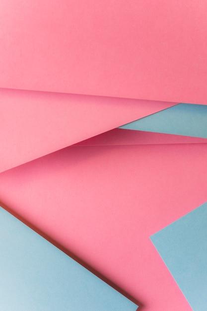 Draufsicht des abstrakten hintergrundes des rosa und grauen kartenpapiers Kostenlose Fotos