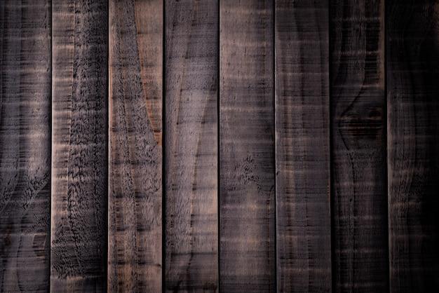 Draufsicht des dunkelbraunen und schwarzen hölzernen beschaffenheitshintergrundes, holztisch. Premium Fotos