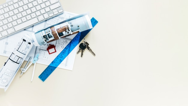 Draufsicht des immobilienschreibtischs mit copyspace hintergrund Kostenlose Fotos