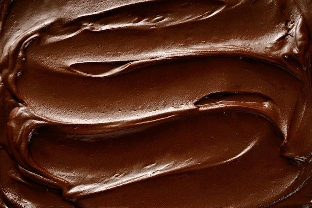 Draufsicht des oberflächenhintergrundes der heißen schokolade Premium Fotos