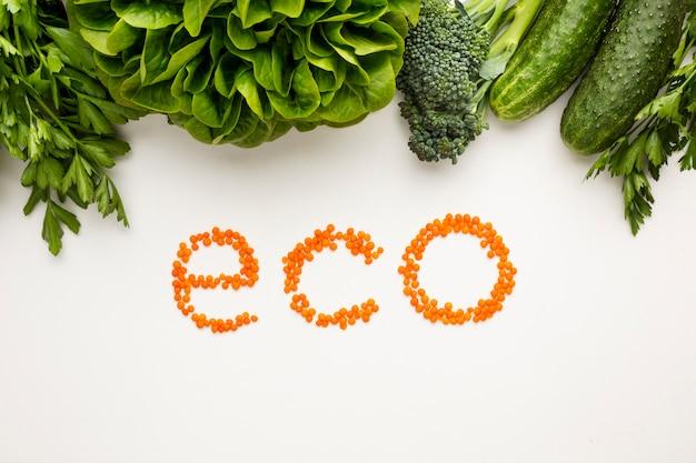 Draufsicht eco beschriftung auf weißem hintergrund Kostenlose Fotos