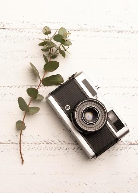 Draufsicht-fotokamera auf holztisch Kostenlose Fotos