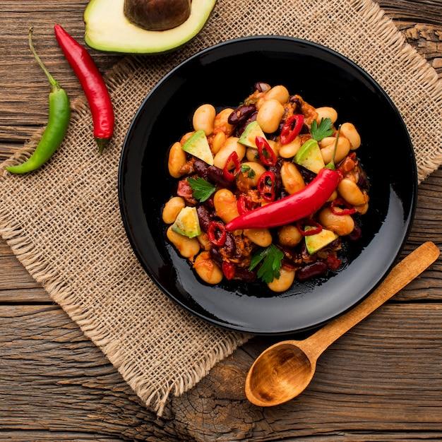 Draufsicht frisches mexikanisches essen auf einem teller Kostenlose Fotos