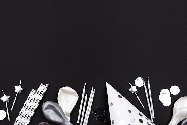 Draufsicht geburtstagsballons und hut Kostenlose Fotos