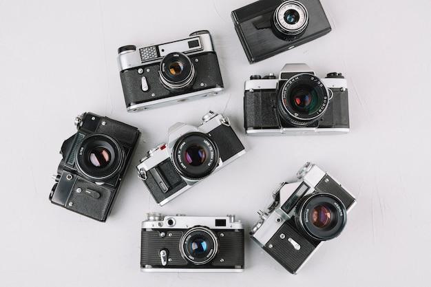 Draufsicht gruppe von professionellen kameras Kostenlose Fotos