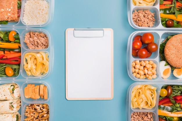 Draufsicht lunchboxen mit leerem notizbuch Kostenlose Fotos