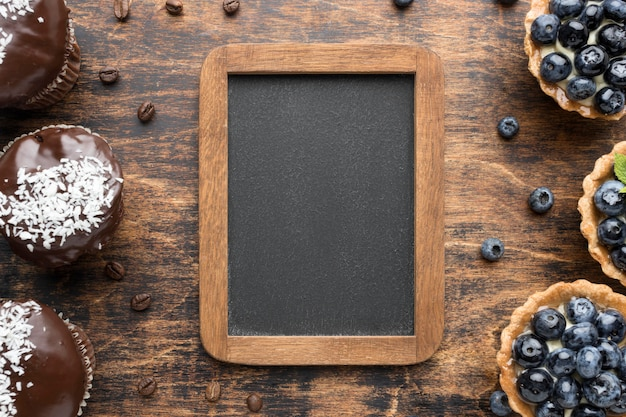 Draufsicht von blaubeerdesserts mit schokolade Kostenlose Fotos