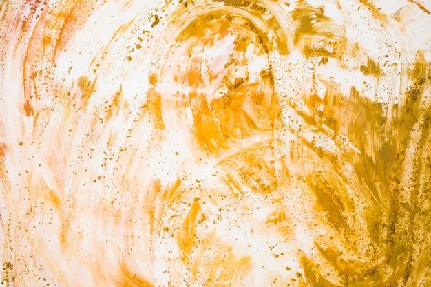 Draufsicht von gelb befleckt auf weißem hintergrund Kostenlose Fotos