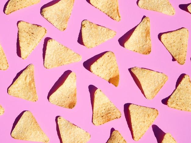 Draufsichtanordnung mit tortilla auf rosa hintergrund Kostenlose Fotos