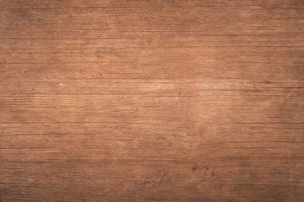 Draufsichtbraunholz mit sprung, dunkler strukturierter hölzerner hintergrund des alten schmutzes, die oberfläche der alten braunen hölzernen beschaffenheit Premium Fotos