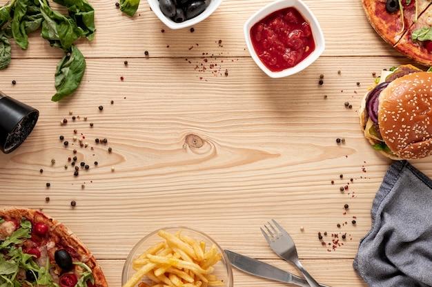 Draufsichtkreisrahmen mit köstlichem lebensmittel Kostenlose Fotos