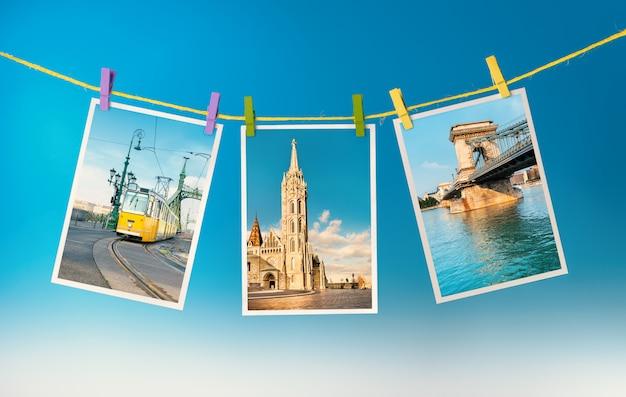 Drei postkarten aus budapest hängen an einem seil Premium Fotos