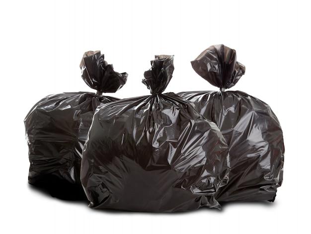 Drei schwarze abfallsäcke Premium Fotos