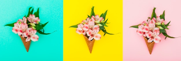 Drei waffelkegel mit blumen auf tabelle Kostenlose Fotos