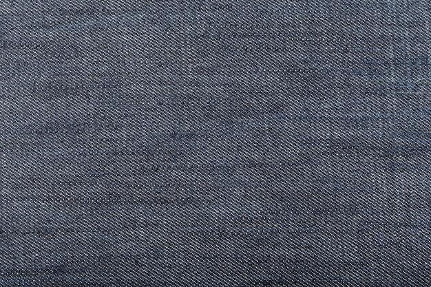 Dunkelblauer denim-stoffhintergrund. nahansicht Premium Fotos