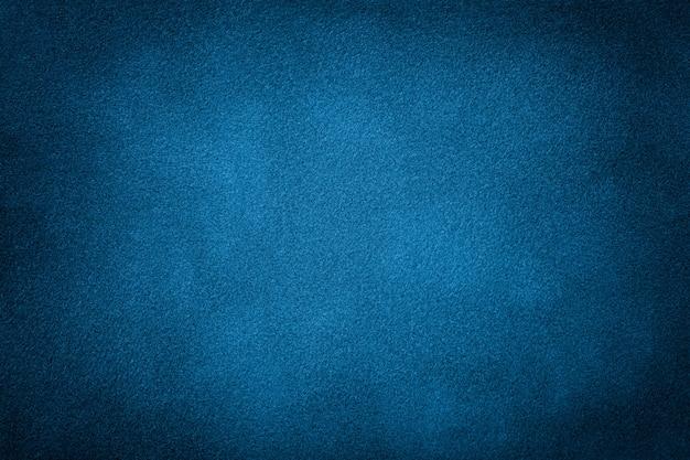 Dunkelblauer matter hintergrund des veloursledergewebes Premium Fotos
