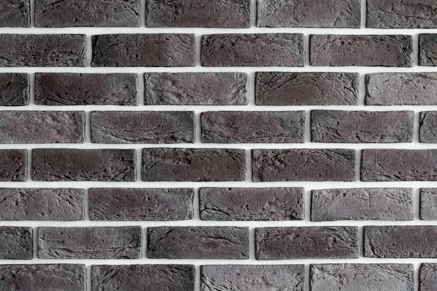 Dunkelbraune backsteinmauer, kreatives hintergrundbild, nahaufnahme Kostenlose Fotos