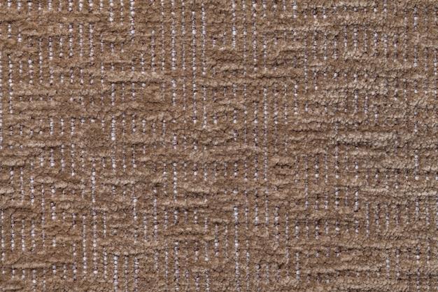 Dunkelbrauner flauschiger hintergrund aus weichem, flauschigem stoff. beschaffenheit des plüschpelzgewebes, nahaufnahme. Premium Fotos
