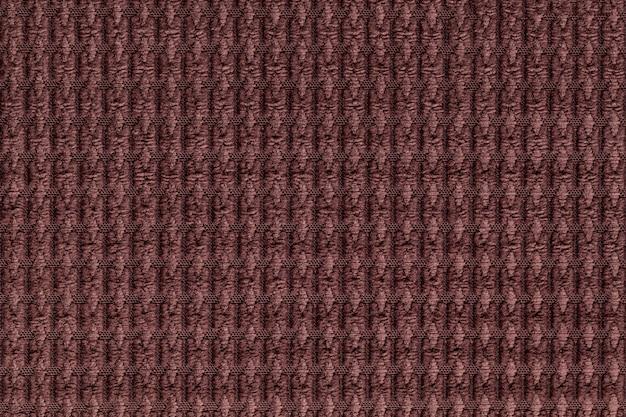 Dunkelbrauner hintergrund vom weichen flauschigen gewebeabschluß oben. textur von textilien makro Premium Fotos