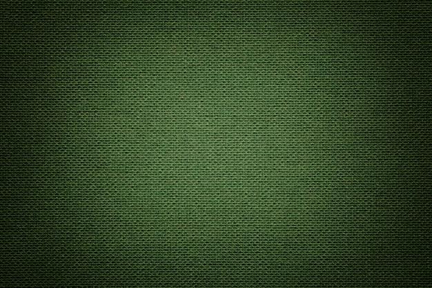 Dunkelgrünes textilmaterial, stoff mit natürlicher textur. Premium Fotos