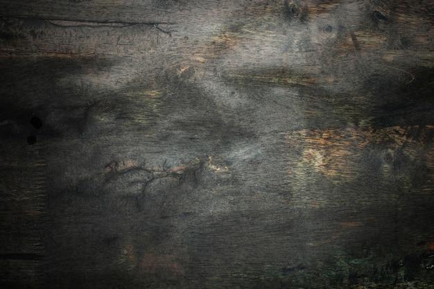 Dunkler alter holz- und schmutzbeschaffenheitswandhintergrund Premium Fotos