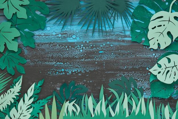 Dunkler blumenhintergrund mit tropischen papierblättern Premium Fotos