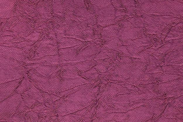 Dunkler purpurroter gewellter hintergrund von einem textilmaterial Premium Fotos