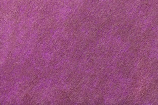 Dunkler purpurroter und brauner hintergrund des filzgewebes. textur aus wollstoff Premium Fotos