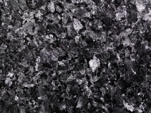 Dunkler strukturierter hintergrund des granitsteins Kostenlose Fotos