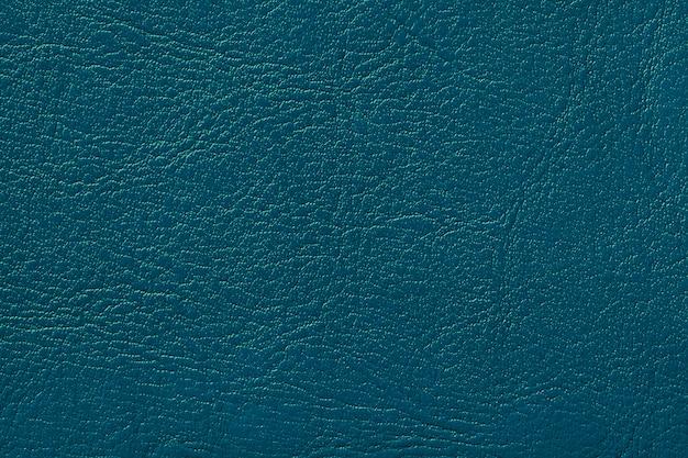 Dunkles marineblau lederbeschaffenheitshintergrund türkis knackte hintergrund von der faltenhaut Premium Fotos