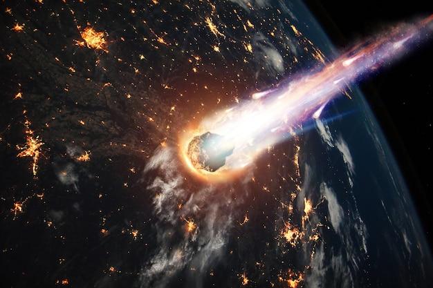 Ein komet, ein asteroid, ein meteorit glüht in die erdatmosphäre. angriff des meteoriten. meteorregen. Premium Fotos