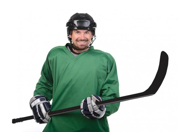Ein mann hält eine keule vor sich und lächelt. Premium Fotos