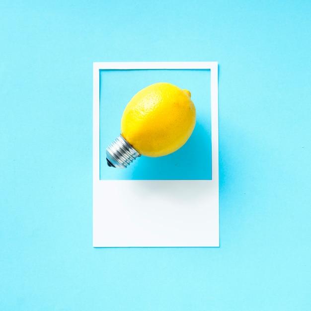 Eine zitrone glühbirne in einem rahmen Kostenlose Fotos