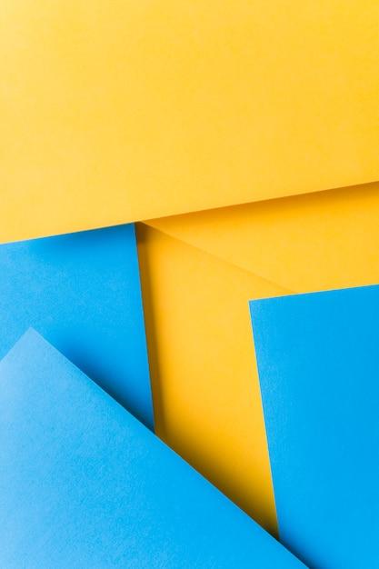 Einfacher geometrischer gelber und blauer kartenhintergrund Kostenlose Fotos