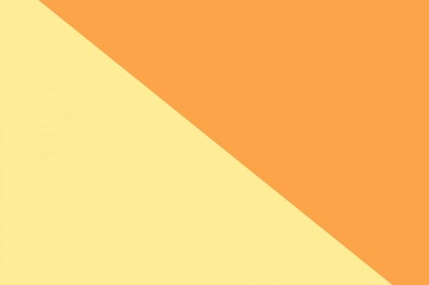 Einfarbiger gelber und orange hintergrund mit zwei tönen. Premium Fotos