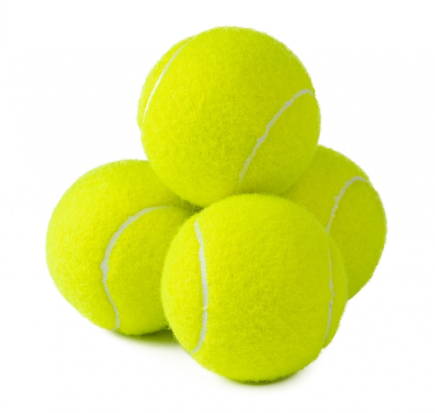 Einige tennisbälle lokalisiert auf weißem hintergrund Premium Fotos