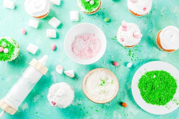 Elemente, um ostern cupcakes mit hasenohren zu machen Premium Fotos