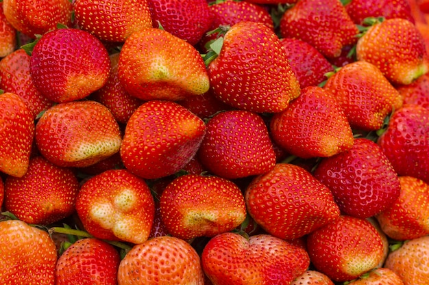 Erdbeerhintergrund intensive rote farbe Premium Fotos