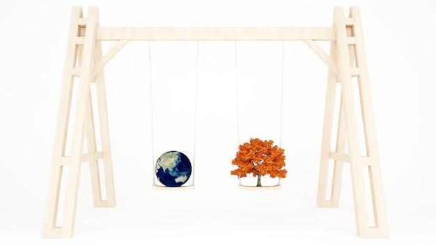 Erde- und ahornbaum auf einem hölzernen schwingen - weltumwelttag Premium Fotos