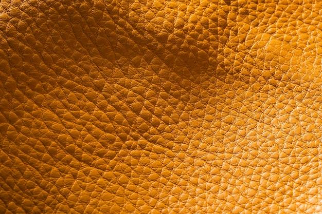 Extrem strukturiertes gelbes brieftaschenleder in nahaufnahme Kostenlose Fotos
