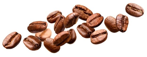 Fallende kaffeebohnen isoliert Premium Fotos