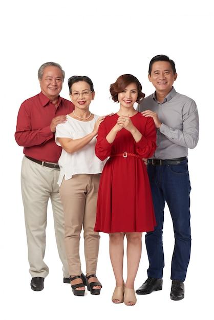 Familie, die gute ferien wünscht Kostenlose Fotos